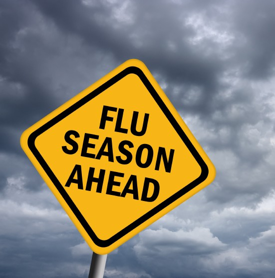 Image of a sign with 'Flu Season Ahead' written on it.