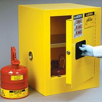 Small countertop flammable cabinet with 1 door being opened.