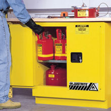 Undercounter flammable cabinet being filled with hazardous substances.